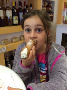 You'll often pleasantly surprised by the gluten-free items you can find while traveling. Here my daughter is enjoying gluten-free cannoli in Sorento, Italy.
